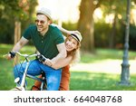 portrait of happy young couple... | Shutterstock . vector #664048768