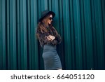 girl with long hair and skirt... | Shutterstock . vector #664051120
