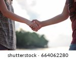 blur women shaking hand with... | Shutterstock . vector #664062280