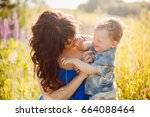 beautiful mother sits with... | Shutterstock . vector #664088464