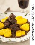 Small photo of Wild boar stew with polenta, cornmeal mush