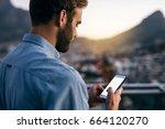 young businessman sending... | Shutterstock . vector #664120270