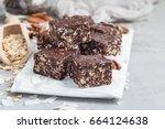 paleo chocolate energy bars...   Shutterstock . vector #664124638