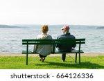an older elderly retired couple ... | Shutterstock . vector #664126336