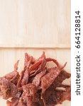 top view of grilled pork jerky... | Shutterstock . vector #664128814