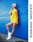 beautiful young woman walking... | Shutterstock . vector #664137670
