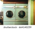 old vintage washing machines... | Shutterstock . vector #664140259
