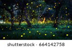 Small photo of Firefly flying in the forest. Fireflies in the bush at night in Prachinburi Thailand. Long exposure photo.
