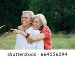 happy couple outdoors | Shutterstock . vector #664156294