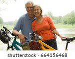 mature couple with bicycles | Shutterstock . vector #664156468