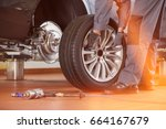 low section of male mechanic... | Shutterstock . vector #664167679