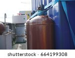 Small photo of Industrial acetylene cylinders secure with webbing sling on deck.