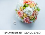 wedding bouquet and rings. | Shutterstock . vector #664201780