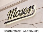Small photo of PRAGUE, CZECH REPUBLIC - JUNE 09, 2017: Moser store sign on wall, is a luxury glass manufacturer based in Karlovy Vary, Czech Republic, previously Karlsbad in Bohemia, Austria-Hungary.