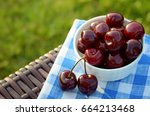 cherry in a white bowl on a... | Shutterstock . vector #664213468