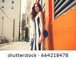beautiful brunette young woman... | Shutterstock . vector #664218478