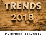 Small photo of trend 2018 word on wood letters. Empty copy space for inscription. wooden background