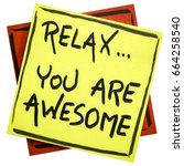 Small photo of Relax, you are awesome - reminder or positive affirmation - handwriting on an isolated sticky note