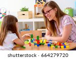 mother and daughter playing... | Shutterstock . vector #664279720