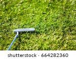 putter on golf course   Shutterstock . vector #664282360