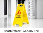 sign showing warning of  wet... | Shutterstock . vector #664307770