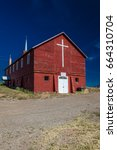 Small photo of APRIL 27, 2017 - PARADOX COLORADO - Paradox Community Center and Church with cross, off State Route 90, Western Colorado near Utah border