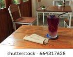 anchan juice on wooden table.   Shutterstock . vector #664317628