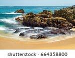long exposure of rocks and... | Shutterstock . vector #664358800