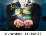 Businessman Holding Data...