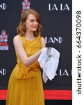 Small photo of LOS ANGELES, CA - DECEMBER 7, 2016: Actress Emma Stone at the TCL Chinese Theatre, Hollywood, where the star of La La Land had their hand & footprints set in cement.