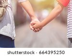 close up woman holding her... | Shutterstock . vector #664395250