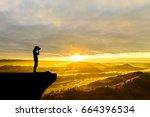 photographer man shooting on...   Shutterstock . vector #664396534