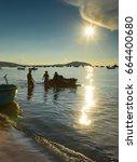 Fishermen Work On Beach In...