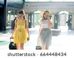 charming young tourists at the... | Shutterstock . vector #664448434