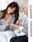 young woman putting nail polish ... | Shutterstock . vector #66444979