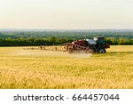works in the fields. spraying... | Shutterstock . vector #664457044