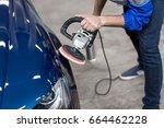 professional mechanic using a... | Shutterstock . vector #664462228