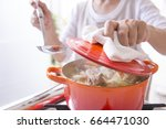 cooking in a casting pot | Shutterstock . vector #664471030
