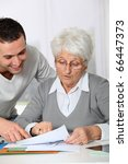 young man helping elderly woman ... | Shutterstock . vector #66447373