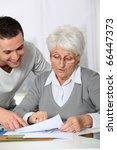 young man helping elderly woman ... | Shutterstock . vector #66447373