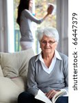 elderly woman reading book... | Shutterstock . vector #66447379