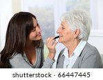 young woman helping old woman... | Shutterstock . vector #66447445