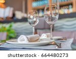 served tables at cafe or... | Shutterstock . vector #664480273