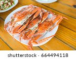steamed blue swimming crab dish.   Shutterstock . vector #664494118