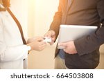business executive exchanging... | Shutterstock . vector #664503808