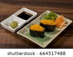 Small photo of Sushi roll with soy souse and Wasabi