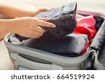 close up of woman packing...   Shutterstock . vector #664519924