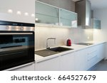 Stock photo modern kitchen interior with with built in appliances 664527679