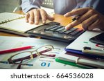 businessman calculating... | Shutterstock . vector #664536028