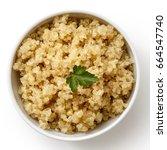 cooked quinoa in white ceramic... | Shutterstock . vector #664547740
